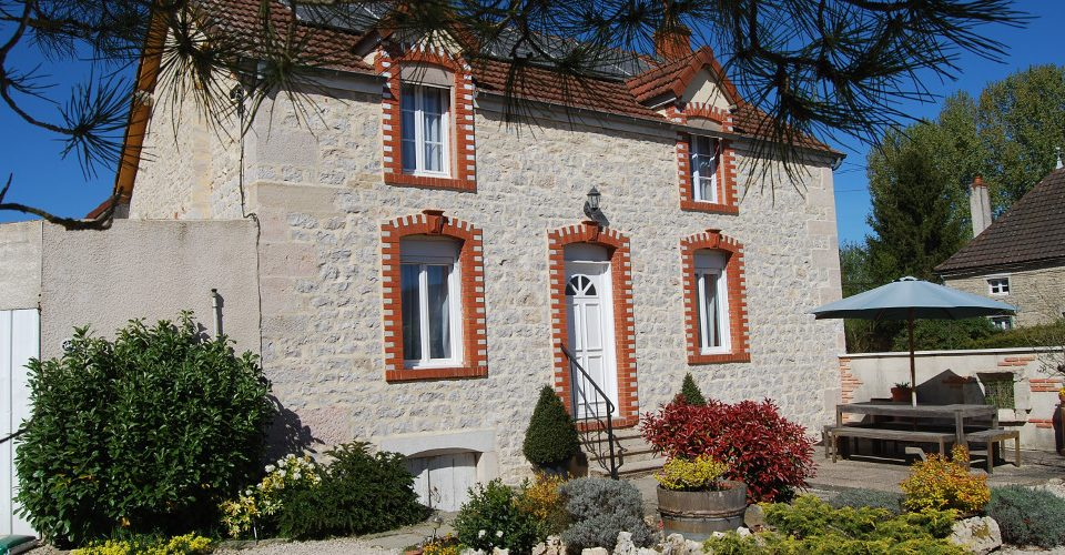 A Building with a clock on the right side of it in the Limousin Region.