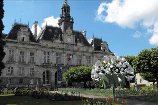 French Architecture Building, Flag Of France Country Flying High And A Cone Shaped White Colored Flower Tree