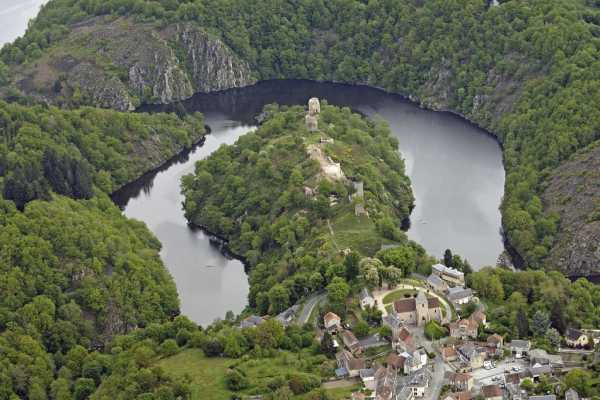 Arial View Of Limousin Region, Buildings, Hills With Water Surrouding Them And Greenery All Over