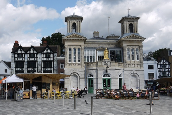 The Italianate Hall In The Market Sqaure With A Golden Colored Statue On Top And Seating The Front Side